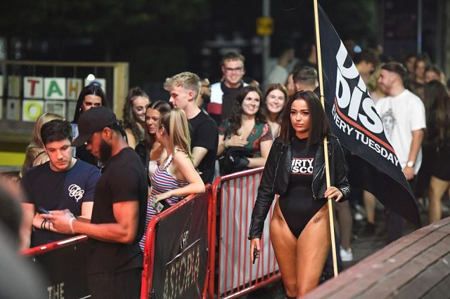 A line of part-goers queue outside Dirty Disco nightclub in Portsmouth just days after the Rule of Six regulations come into force