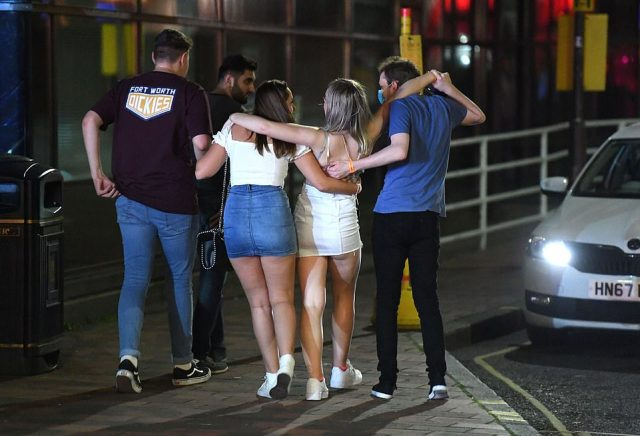 Party-goers walk along the street in Portsmouth just days after the Government's Rule of Six comes into force in the UK