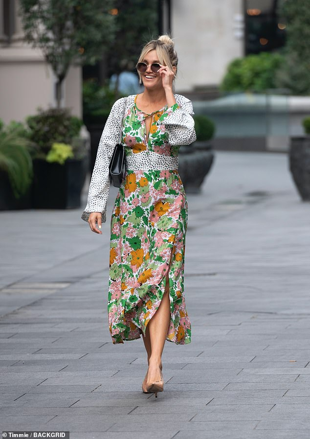 She's got style: The Pussycat Dolls singer, 39, looked super chic in a silk floral and Dalmatian print maxi dress