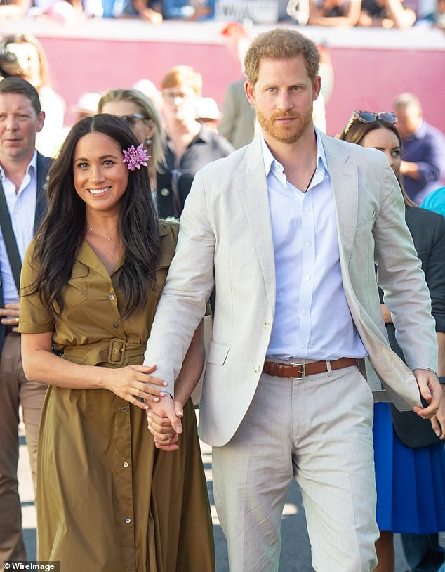The Duke and Duchess of Sussex made a $130,000 donation to a girls' education charity to mark their recent birthdays, it has been revealed. Pictured, the couple in Cape Town last year