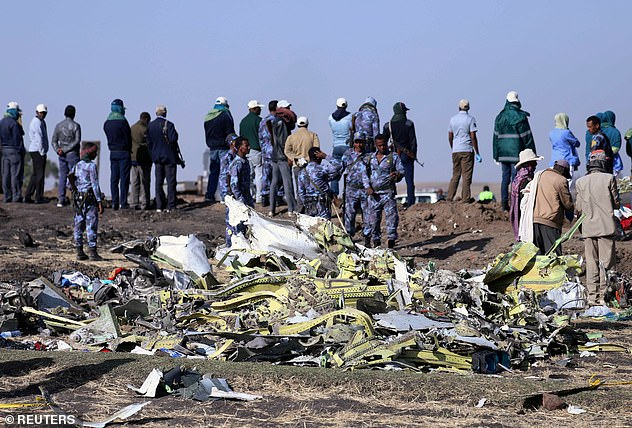 Ethiopian emergency services work at the scene of the crash near Addis Ababa on March 10, 2019
