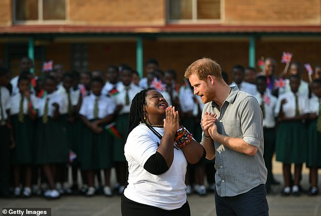 The Duke of Sussex Angeline Murimirwa, the Executive Director of Africa CAMFED, during his visit the Nalikule College of Education in Malawi during the royal tour last autumn