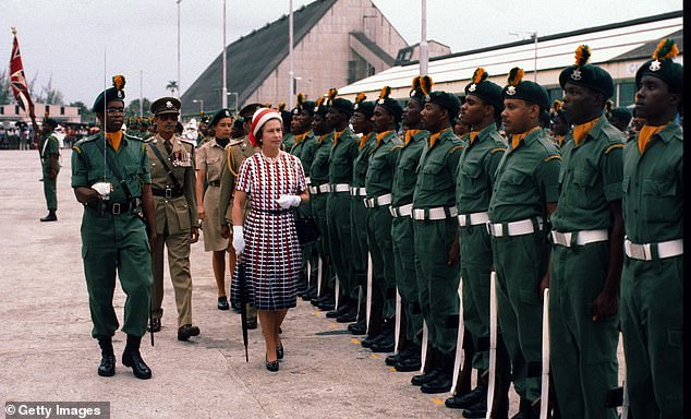 The Queen inspects a guard of honour upon arrival in Barbados in 1977