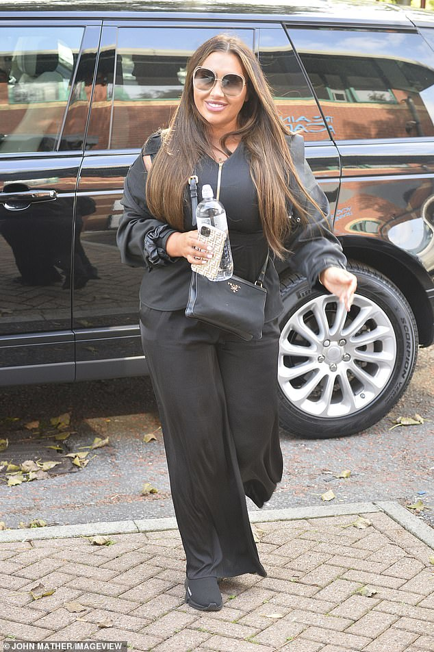Less is more:Lauren Goodger put on an uncharacteristically casual display as she headed to beauty training centre Cosmetic Couture Clinic in Manchester on Wednesday