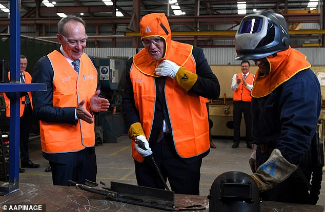Scott Morrison (pictured welding steel at a factory visit in Newcastle on Tuesday) will invest $1.9billion over the next ten years on new energy technologies