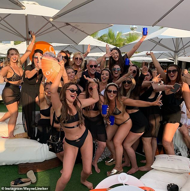 Taking to Instagram, Wayne (pictured centre, surrounded by a group of women) wrote: 'So, my family have decided I need a girlfriend for my own sanity and health...so here¿s my criteria'