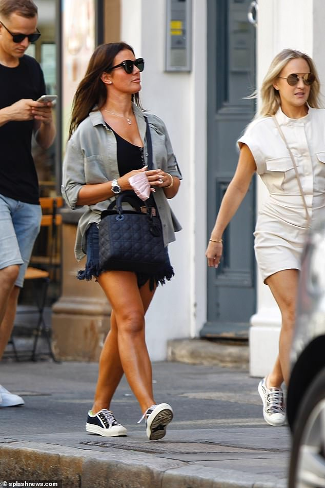 Fun in the sun:The 38-year-old WAG seemed in good spirits as she enjoyed a girls' day out in the capital, with the trio making the most of the balmy weather with a relaxed stroll