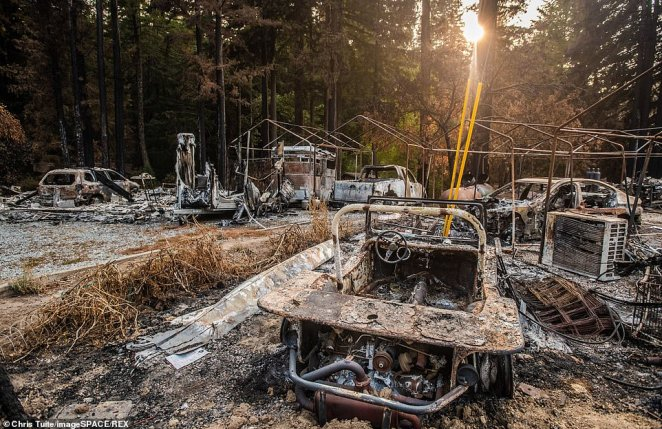 A view of burned out vehicles on Big Basin Road in Felton, California after the massive CZU Lightning Complex tore through