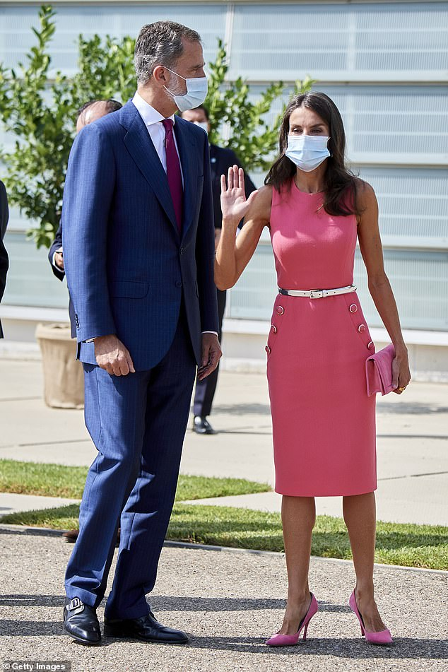 The couple looked in great spirit, with Felipe VI looking dapper in a blue suit and Letizia sporting pink from head to toe