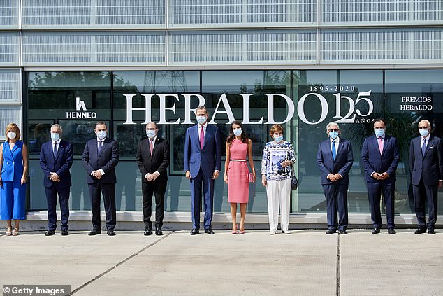 Queen Letizia of Spain stole the show with a hot pink number as she joined her husband Felipe VI in Zaragoza today. The Spanish royal, 48, recycled a dress from the Michael Kors Collection to mark the 125th anniversary of local paper El Heraldo de Aragon (Aragon Herald) this afternoon at the newspaper's headquarters