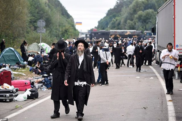 Jewish pilgrims gather on the Belarus-Ukraine border, in Belarus, Tuesday