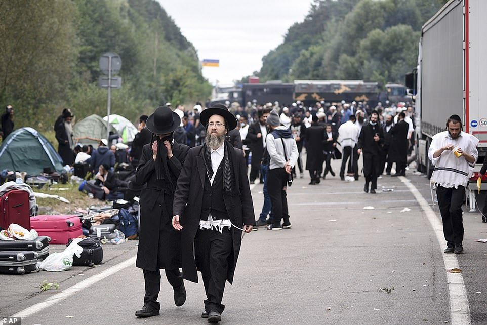 Jewish pilgrims gather on the Belarus-Ukraine border, in Belarus, Tuesday