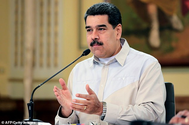 This handout photo released by the Venezuelan Presidency shows Venezuela's President Nicolas Maduro delivering a speech at Miraflores Presidential Palace in Caracas, on April 23, 2019