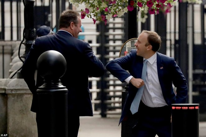 Health Secretary Matt Hancock seemed in high spirits despite the testing shambles as he greeted chief whip Mark Spencer in Downing Street today