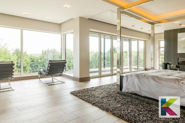 The master suite also comprises separate 'His' and 'Hers' dressing rooms and en-suite bathroom, along with scenic views
