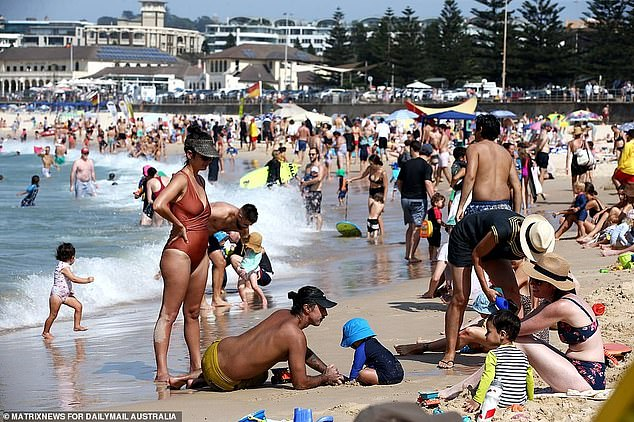 Apsiring Australians will face a new challenge from November 15 with changes to the Australian Citizenship test (pictured: Bondi Beach is packed with revellers celebrating Australia Day in January 2020)
