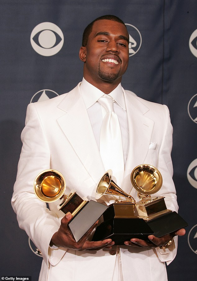 West has won a whopping 21 Grammy Awards across the past two decades. He is pictured with three of the accolades back in 2005