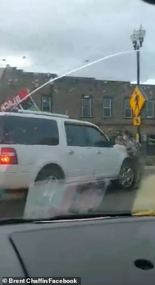 The driver of the Ford Expedition, later identified as Lafer, heads straight at the protester, knocking him to the ground before driving over him and leaving the scene