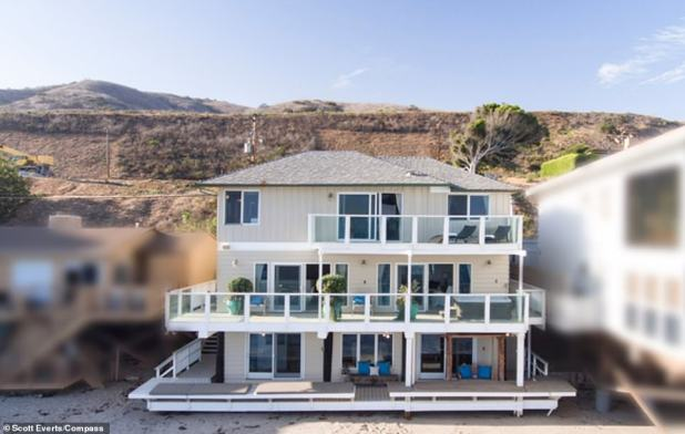 Sold!  The 4,400-square-foot house is right on the beach, staring out into the Pacific Ocean with an outdoor deck that is perfect for watching the sunset