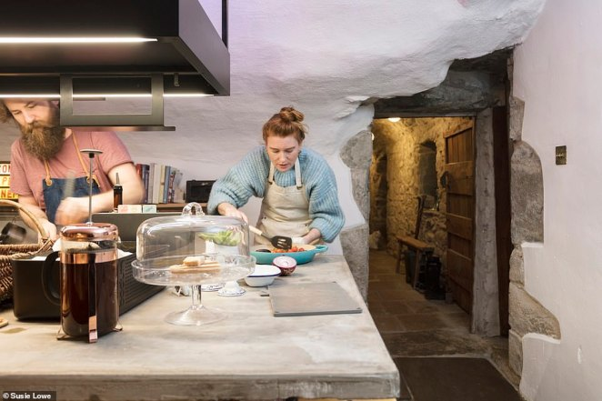 Simon and Stef hard at work preparing food in the castle's country-style kitchen