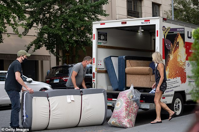 Manhattan residents are seen packing a U-Haul on Saturday. A new poll has found that nearly half of New York City's highest earners have considered moving elsewhere