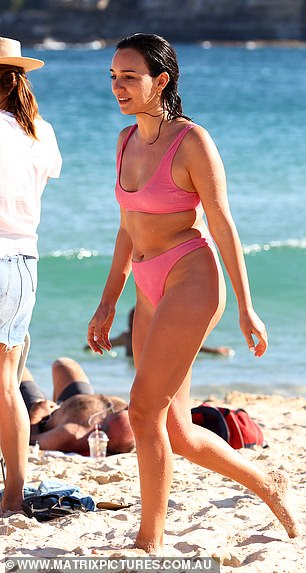 Pretty (hot) in pink! Marketing consultant Bella, 25, stood out in a sea of people in a high-cut hot pink bikini that accentuated her tan