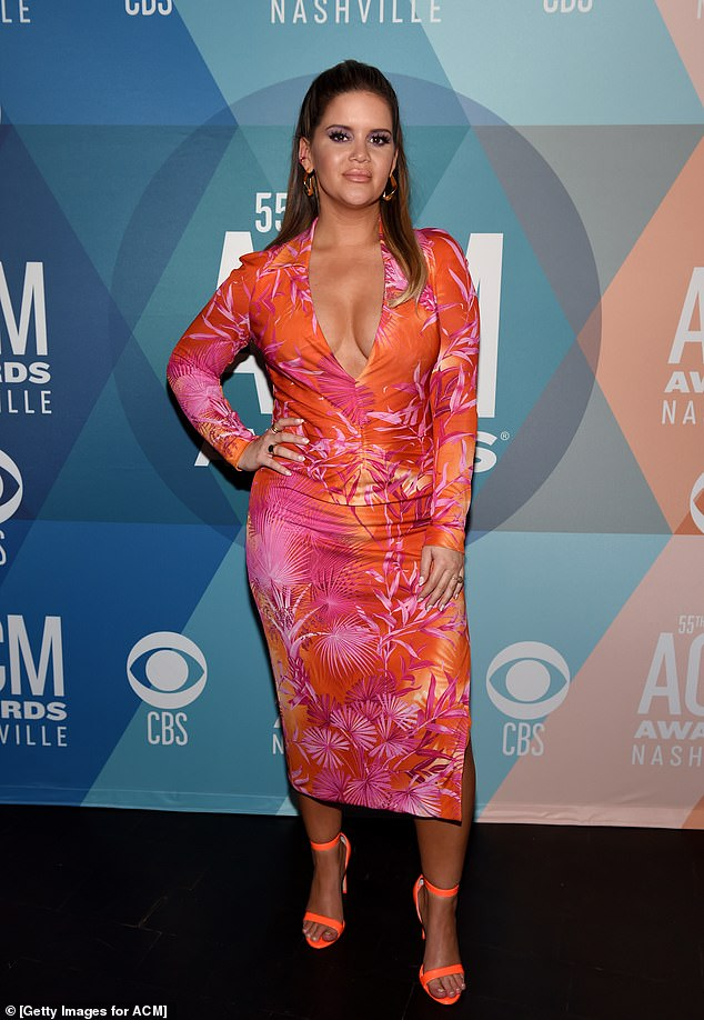 Stunning: Maren flaunted her curves in her low-cut, long-sleeve dress, which featured bursts of fiery orange and deep crimson