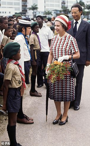 Visits: Queen Elizabeth ll is picturedon a walkabout during a visit to Bridgetown