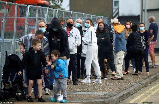 People queue at a test centre following an outbreak of the coronavirus  in Southend-on-sea, Essex, on Wednesday