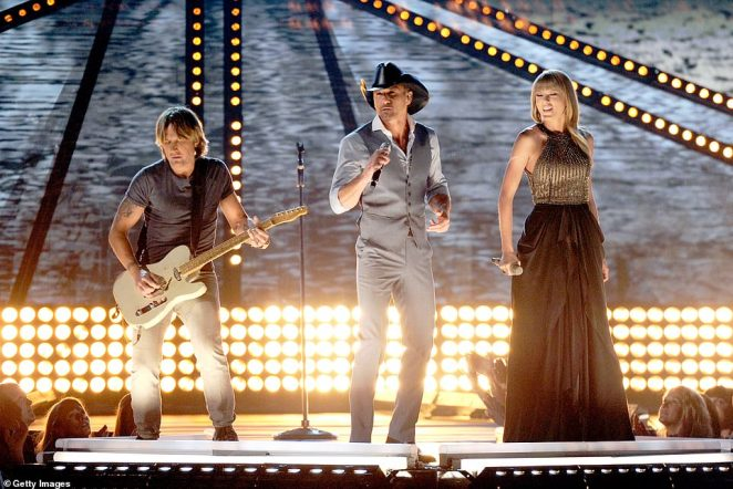 Epic: She performed the hit Tim McGraw song Highway Don't Care with the 53-year-old country legend, himself, and Keith Urban; Keith, Tim, and Taylor pictured in 2013