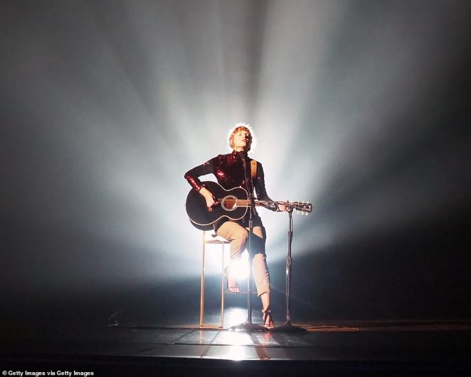 Guess who's back: Taylor Swift returned to the ACM stage to deliver the world premiere performance of her hit song Betty at the Grand Ole Opry House