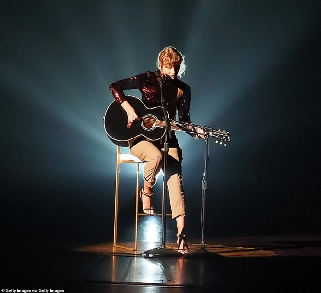 Her roots:The 30-year-old singer-songwriter wielded a black acoustic guitar and remained seated on a stool as she effortlessly performed the emotionally-charged track