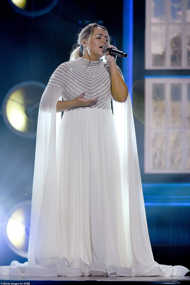 Angel:American Idol's very own Gabby Barrett served major angel vibes in a chiffon floor-length gown that featured a jewel-covered bodice