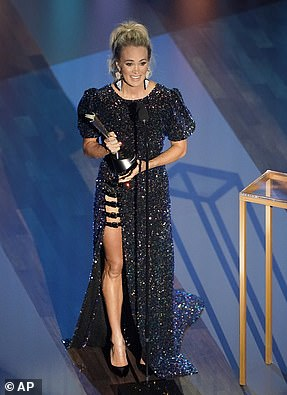 Golden Girl: Carrie Underwood took top honors for Entertainer of the Year with Thomas Rhett in a historic tie