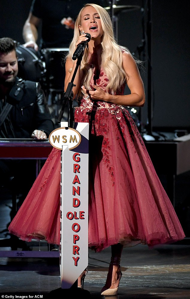 Queens of country: Carrie Underwood paid tribute to Dolly Parton, Patson Cline and other queens of country Wednesday, as she performed a medley of hits at the 55th Academy of Country Music Awards