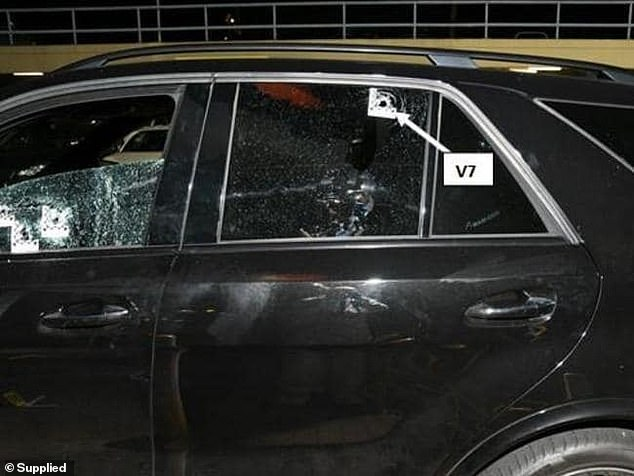 The bullet-riddled Mercedes that Mick Hawi was gunned down in is above in a court exhibit