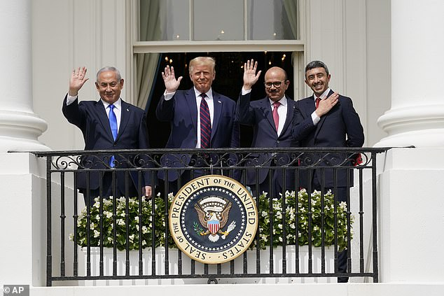 It comes after Israeli Prime Minister Benjamin Netanyahu (left), Bahrain Foreign Minister Khalid bin Ahmed Al Khalifa (second right) and UAE Foreign Minister Abdullah bin Zayed al-Nahyan Abraham (right) joined Trump in Washington to sign a pact with Israel