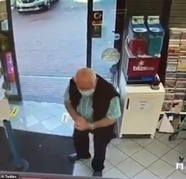 The man rubs his hands with the ice cold sticky substance before walking further into the store