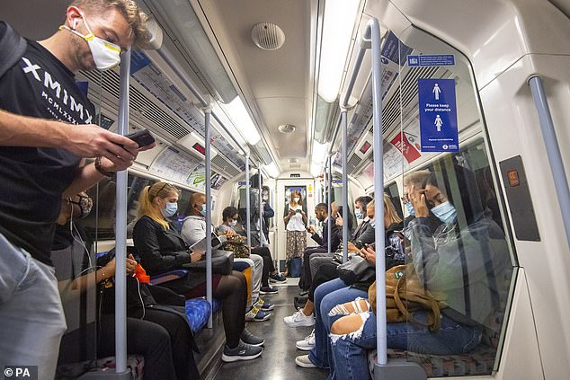 UK sales of PPE have surged during the pandemic (passengers on the Tube pictured)