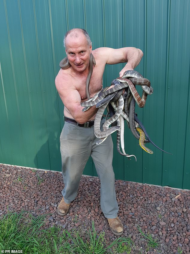 Raymond Hoser removed the 1.2-metre long reptile from a bowser at a Coles Express service station in Nunawading, west of the city, on Wednesday
