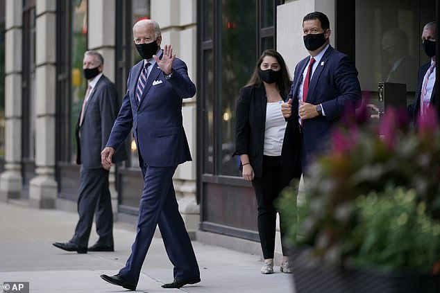 Pictured:Democratic presidential candidate former Vice President Joe Biden departs after attending campaign meetings at the Hotel du Pont in Wilmington, Delaware