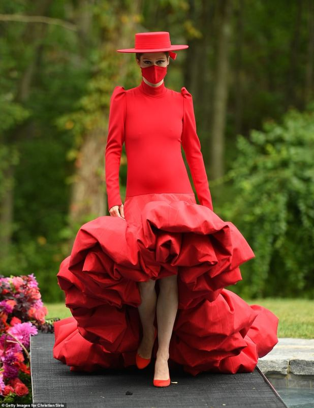 Lady in Red: Coco Rocha designed Christian Sirano's NYFW show on Thursday, held along the runway above the swimming pool at the designer's Connecticut estate