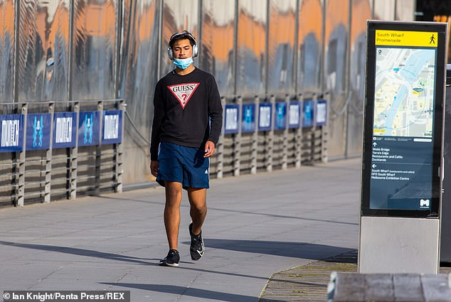 Victoria recorded 45 new coronavirus cases and four deaths on Friday. Pictured: A residentwalks along South Wharf in Melbourne as part of their permitted exercise on Wednesday