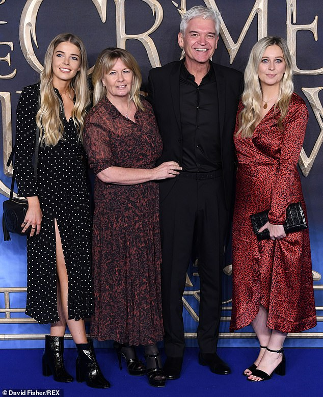 Plans: Phil apparently had no plans to move on and would be up against a costly divorce battle - especially with his earnings at a 'record high'. Photographed with family in 2018
