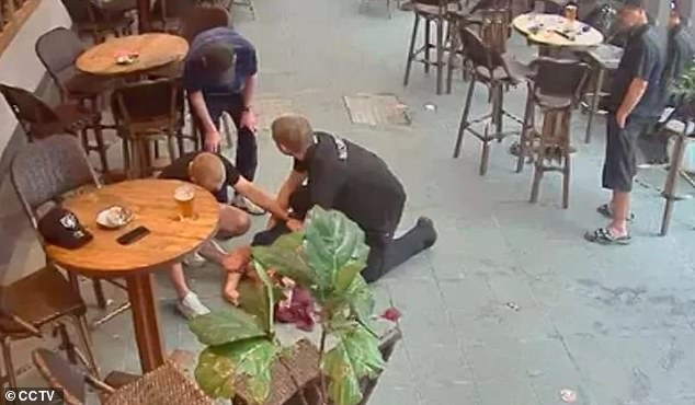 Security officers helped the pub patron who fell flat on his back before being taken to hospital for two days