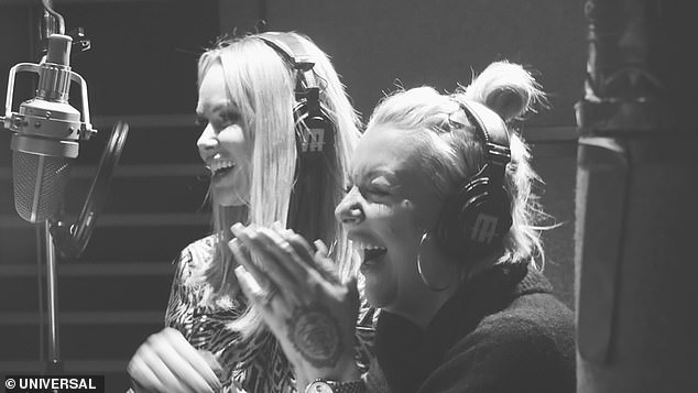 Famously friends: Amanda Holden, (left) and Sheridan Smith giggled and embraced in music still for new duet I Know Him So Well from Chess The Musical, which comes out on Friday