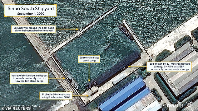Analysts say there has been a wave of activity at the Sinpo South shipyard, where the North is building submarines (pictured earlier this month)