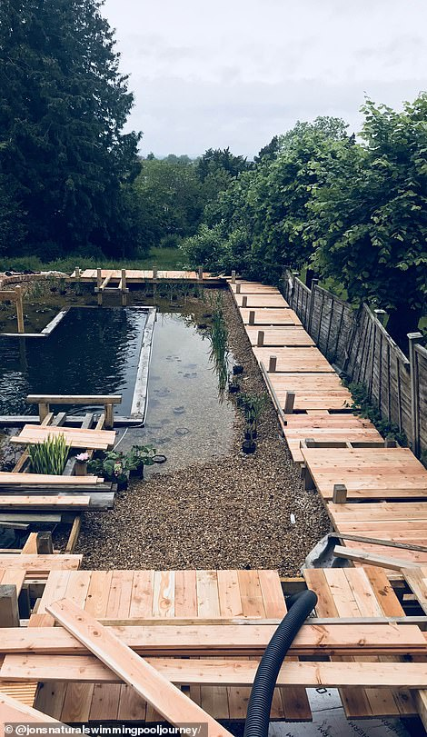 'Jon's natural swimming pool' comes complete with a sauna and decking (pictured during construction)