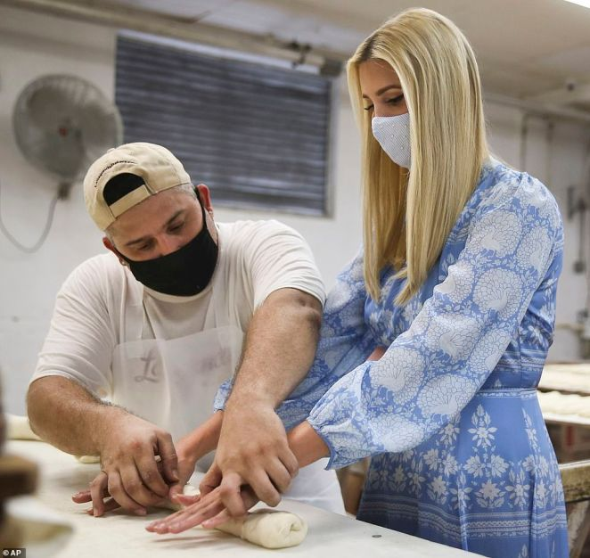 Into it: Ivanka Trump learned how to roll out dough for Cuban bread while visitingLa Segunda Bakery in Tampa, Florida, on Thursday