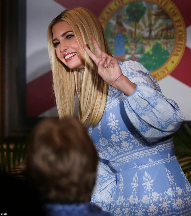 All smiles: The White House senior adviser flashed the peace sign before sitting down